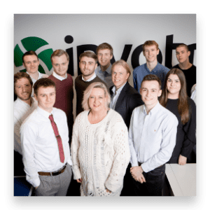 apprentices in front of invotra logo