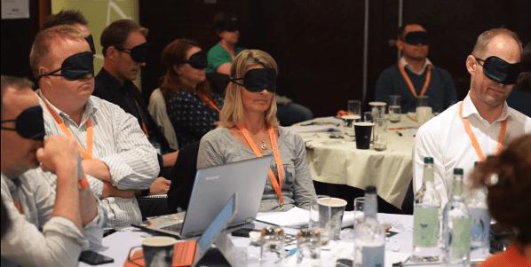 people wearing blindfolds at intranet now conference