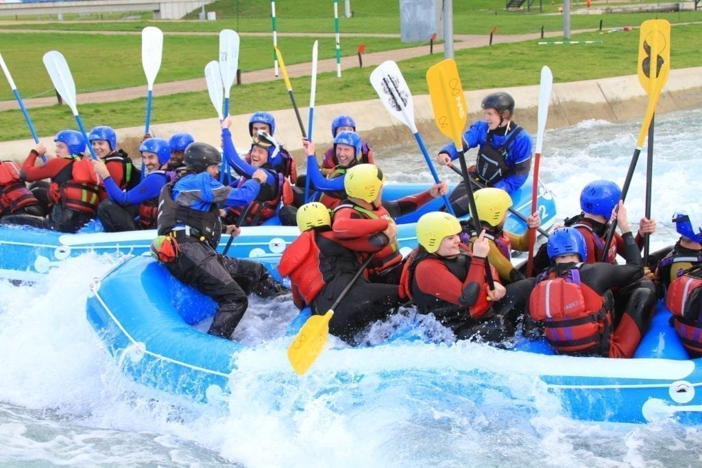 invotra team water rafting paddles up