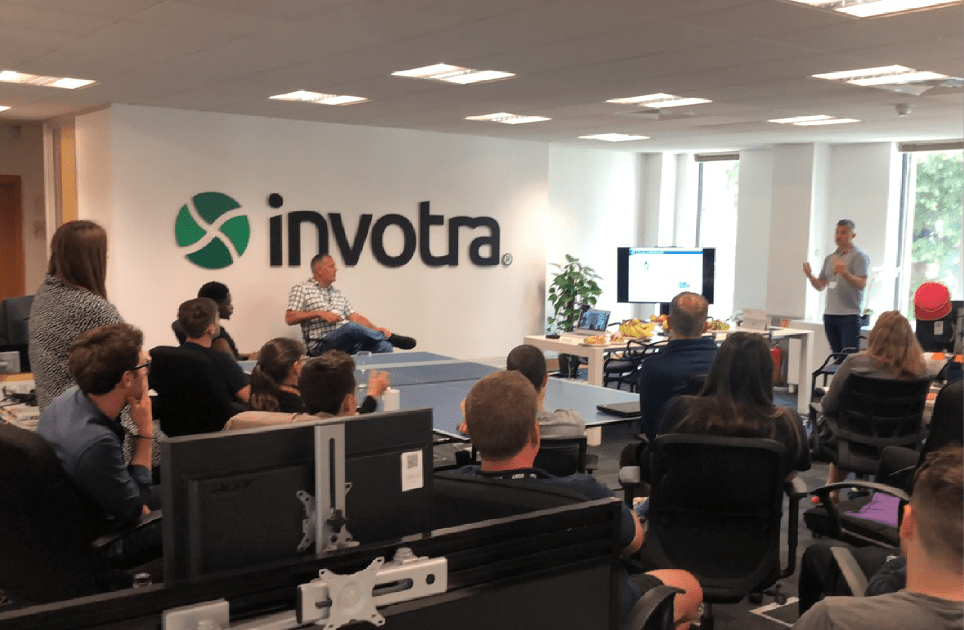 Photograph of the Invotra team listening to Neil Owen's presentation on Giving employees a voice